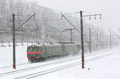 Train on the snowy railway Stock Photo