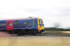 Train at speed. A train moving quickly, motion blurred Royalty Free Stock Photography