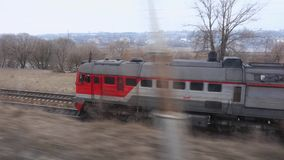 Russian disel cargo train in Siberia. Train speed rides on railway stock footage