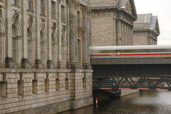 Train speeding between large museum buildings Royalty Free Stock Photos