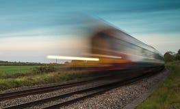 Train speeding passed stock image