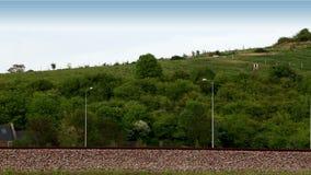 Train speeding past fields stock footage