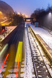 Train Speeding Through Snow Covered Station Royalty Free Stock Photography