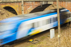 Train. Speeding trains glide along the tracks Stock Images