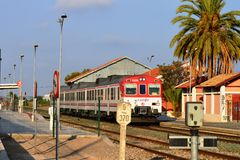 A train speeds through the station in Torreliano Spain Royalty Free Stock Image