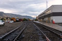Deserted Tracks in a Train Station on a Cloudy Summer Day Stock Images