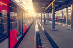 Train stands by the platform. Royalty Free Stock Image