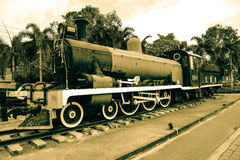 A train of State Railway of Thailand manument in sepia color Royalty Free Stock Photos