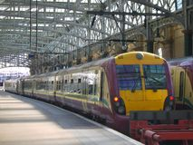 Train In A Station. Train at a platform in Glasgow Central station, Scotland, UK Royalty Free Stock Images