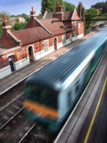 Train in station. Typical English station with mainline train speeding through Stock Photo