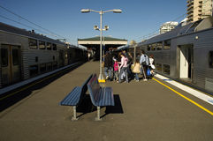 Train station. People getting out of a train in outdoor railway station, location: Sydney - Kirribilli Stock Images