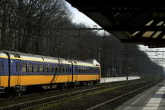 Train station. Yellow and blue train waiting at a train station royalty free stock photography