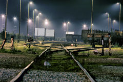 Train station. For cargo wagon - night shot , many street lamp and blank jumbo poster in back Stock Photography
