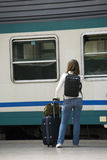 At the train station. A girl at a Milan train station Stock Image