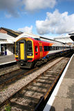 Train in station. Passenger train standing at platrorm Royalty Free Stock Images