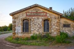 Train station at the abandoned railroad network in Greece. View of an old, stone, train station at the abandoned railroad network of Peloponnese, Greece royalty free stock image
