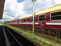 A train station. Train station in Brasov along with a train coming in Stock Photos