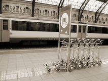 Train station carts in sepia. Row of baggage carts in a train station done in sepia for a vintage look Stock Photography