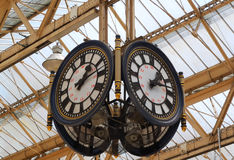 A train station clock. With four faces and speakers Stock Photography