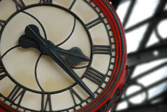 Train Station Clock. A large clock in an English train station keeps the passengers notified of the time Stock Image