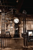Train station clock. Old train station in York, colors, brick wall, posters, inscriptions on the wall, history, visiting the old trains, clock Royalty Free Stock Image