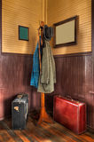 Train Station Coat Rack & Luggage in Corner Stock Images
