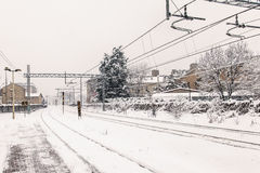 Train station covered by snow. Train station and its railway covered by snow This image reminds of a typical winter cold day royalty free stock photo