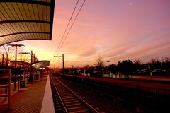 Dawn breaking upon a commuter train station Royalty Free Stock Image