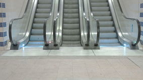 Train Station Escalators. Loopable shot of escalators running both up and down stock footage