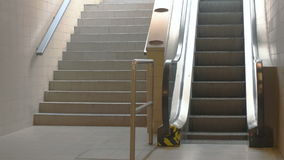 Train Station Escalators. Shot with escalator visualy dominating over staircase stock footage