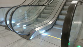 Train Station Escalators. Side view of escalator stairs running up stock video footage