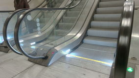 Train Station Escalators. Side view of escalator stairs running up, people in the frame stock footage