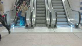 Train Station Escalators. Wide angle separated shot of up and down running escalators, people in the shot stock footage