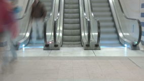 Train Station Escalators. Wide angle timelapse of escalators running up and down, people in the shot stock video footage