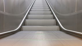 Train Station Escalators. Wide and low angled scene of running escalator stairs stock footage