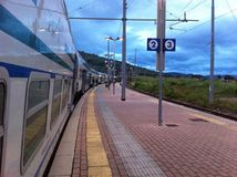 Train station in the evening. Train stopped at the station Royalty Free Stock Photos