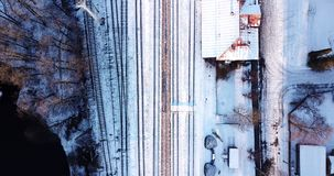 Train station filemd from above. Aerial view of train station from above. Camera slowly rises up stock video footage