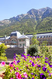 Train station in front of some purple flowers, Canfranc. Spain Stock Photos