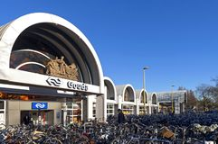 Train station Gouda with overcrowded bicycle parking. The Netherlands, province South Holland, city Gouda: frontage of railway station and zuid holland masses of royalty free stock photography