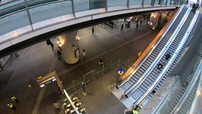 Train Station hall people commuting timelapse. Moving timelapse of station Amsterdam Bijlmer Arena, where people are walking around to their destination and stock video footage