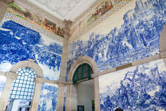 Train station hall of Porto, Portugal. Porto railway decorated with amazing painted ceramic tiles wich depict scenes of the Histoy of Portugal Royalty Free Stock Images