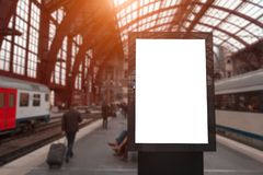 Train station informational empty billboard with mockup, near people and trains.  royalty free stock image