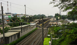Train station in the middle of houses photo taken in Jakarta Indonesia Royalty Free Stock Photo