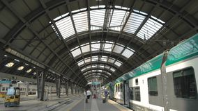 Train at the station. 18.06.2016 - Milan, Italy train at the station people on railway platform stock footage