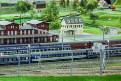 Train station. Miniature train station and green pastures Stock Image