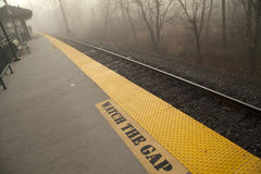 Train station on a morning mist Royalty Free Stock Photography