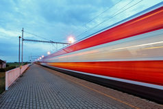 Train station in motion blur at night, railroad Stock Images