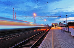 Train station in motion blur at night, railroad.  Royalty Free Stock Image