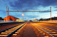 Train station in motion blur at night, railroad Royalty Free Stock Image