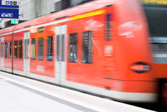Train station with moving train Royalty Free Stock Photo